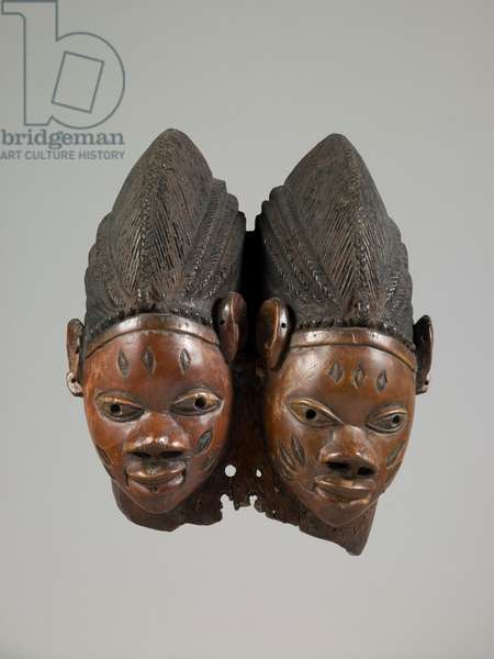 Double Mask for the Gelede Society, attributed to Eshubyi workshop, mid to late 19th century (wood, pigment, & traces of indigo)