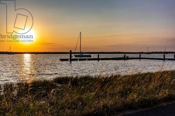 """Summer sunset at Rochefort in Charente Maritime, on the river """"La Charente"""", France, 2019 (photo)"""