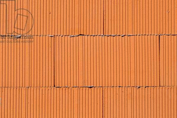 Brick texture, three rows of orange bricks close up view, 2020 (photo)