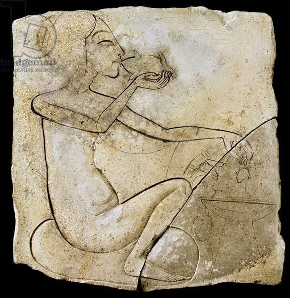 Amarna Period artist's study of a princess eating roast duck, from Tell Al-Amarna, New Kingdom (limestone)