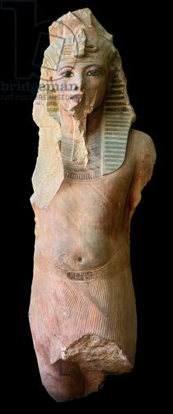 Colossal statue of Tutankhamun, from the 'Temple of the Millions of Years' of Ay and Horemheb, Medinet Habu, New Kingdom (painted quartzite)