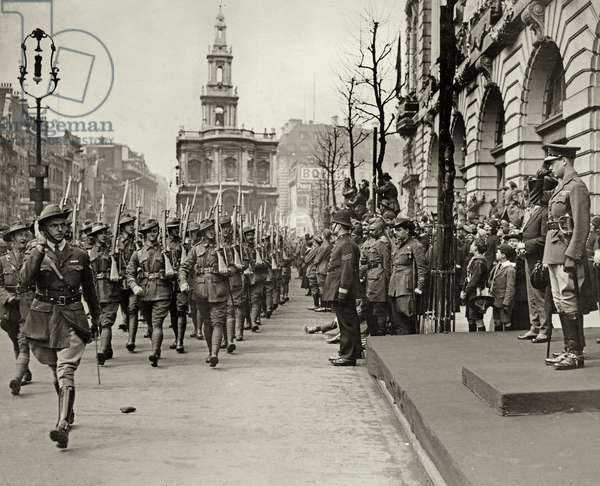 The Prince of Wales taking the salute of Australian troops outside Australia House, during the Peace Day procession, 1919 (b/w photo)