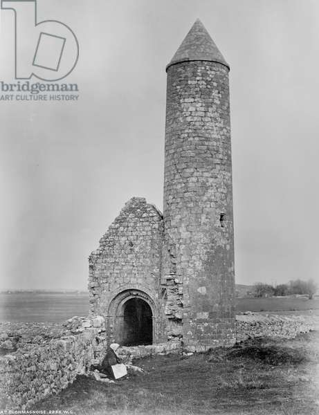 One of the round towers and a section of the ruins at Clonmacnoise, County Offaly, Ireland, c.1890 (albumen print)
