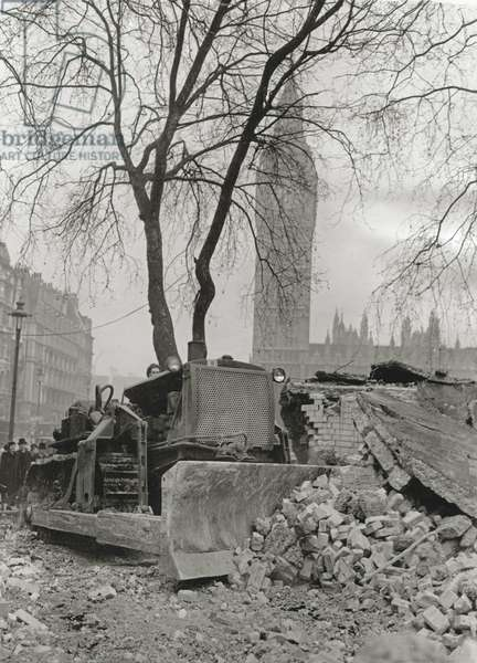 Work beginning on the rebuilding of the House of Commons, a bulldozer assisting the demolishing of air raid shelters at Westminster to clear the site for the new chamber, 26th February 1946 (b/w photo)