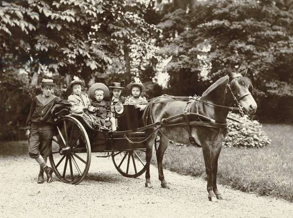 Children in a horse-drawn carriage (b/w photo)