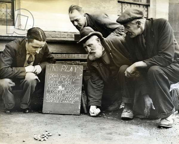 Practising for the Marbles Championship of the World, 12th March 1937 (b/w photo)