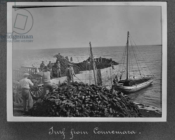 Turf from Connemara being brought to the Aran Islands, c.1910 (sulphur toned gelatin silver print)