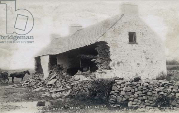 The Cleary house after battering ram, eviction at the Vandeleur Estate, County Clare, Ireland, 1888 (b/w photo)