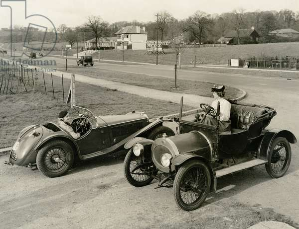 A 1910 and 1935 model of the Riley Motor car side by side, 1935 (b/w photo)