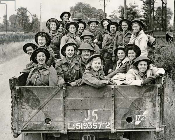 Members of Queen Alexandra's Imperial Military Nursing Service arriving in Normandy, 1944-45 (b/w photo)