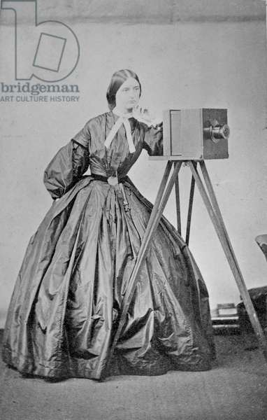 Lady Augusta Crofton, with her sliding box wet plate camera, a present from her father from the Great Exhibition of 1851, c.1860 (gold-toned albumen print)