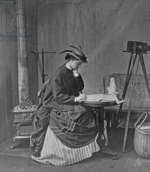 Augusta Crofton at a writing table, c.1865 (albumen print)