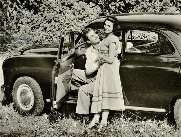 A couple with a motor car (b/w photo)
