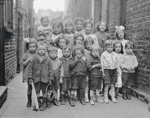 Group portrait of boys and girls from a poor neighbourhood, London, c.1890-1910 (b/w photo)