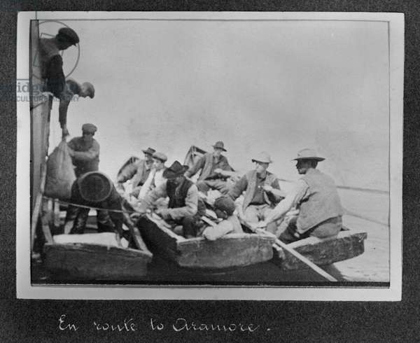 Supplies for the Aran Islands being unloaded by the local men in their boats, c.1910 (sulphur toned gelatin silver print)