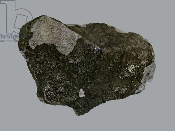 Achondrite of Vesta (Euchrite). Found in France on the banks of Lake Bouvante (Drome) in 1978. Museum National Histoire Naturelle de Paris.