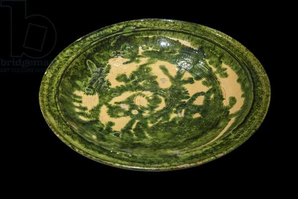 Plate decorated with green coulures. North-West Iran or Caucasus, 11th-12th century. Ceramic, grave decor and painted. Louvre Museum
