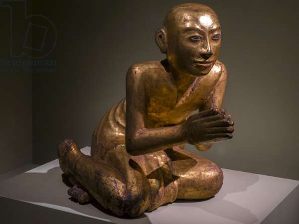 Monk kneels in prayer. Burma (Myanmar). Mandalay period, 19th century. Lacquer, Golden and Painted Wood.