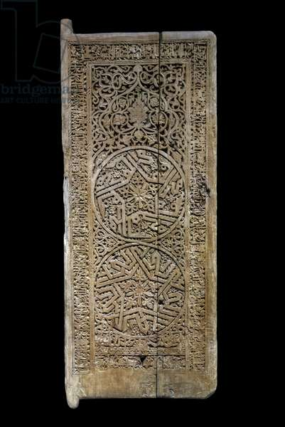 Door leaf. Iraq or Iran, 520 H./1126. Carved wood, grave, traces of painted decor (?). Louvre Museum