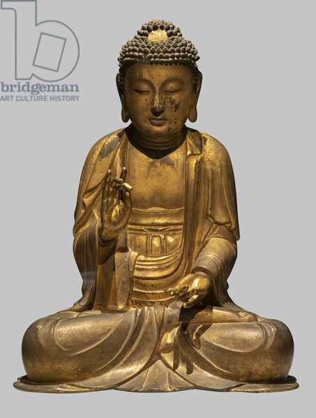 Sitting Buddha making the gesture of predication. Korea, Koryo period, 11th-12th century. Golden wood.