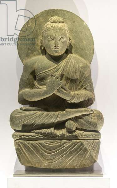 Buddha making the gesture of the wheel of the Law in motion. Pakistan, Art of Gandhara, 4th and 5th. Shale.