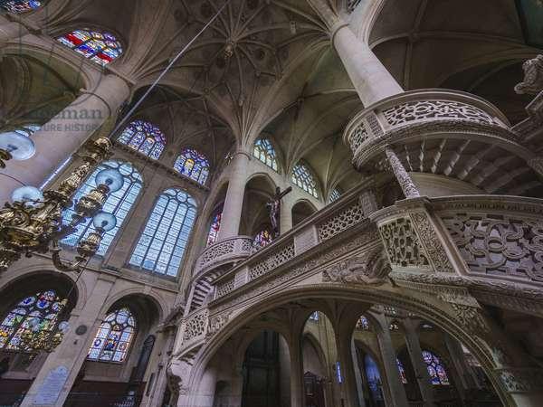 The jube, detail, the staircase wraps around a pillar. Church Saint Etienne du Mont, Paris, (1491-1624)
