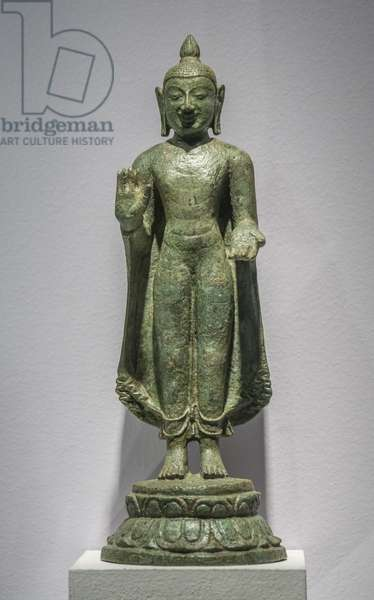 Buddha making gestures of absence of fear and gift. South India, Chola Period, 10th-11th century. Bronze.