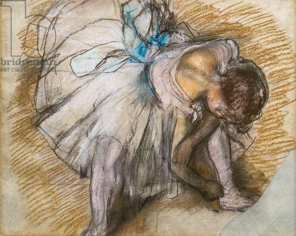 Dancer adjusting her shoe. 1885. Pastel on paper.
