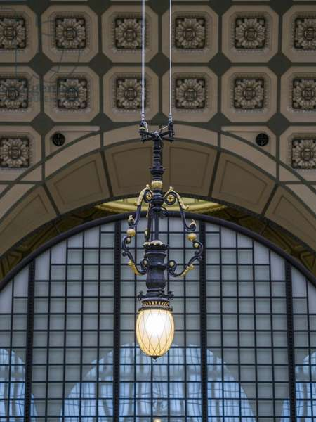 The Orsay Museum. Paris. France - Hanging lamp from the main room, in front of glass and steel sctucture and macaroons decor - Musee d'Orsay, Paris - Photography 2017