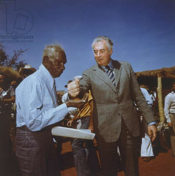 Prime Minister Gough Whitlam (b.1916) pours soil into the hands of traditional land owner Vincent Lingiari, Northern Territory, Australia, 1975, printed 1991 (cibachrome photo)