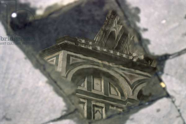 Church reflecting in a puddle (photo)