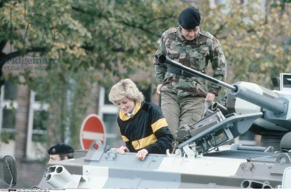 Lady Diana Princess of Wales 10/85 rud wife Princess England UK nobility wife of Prince Charles of Wales blond casual jacket armored soldier outside call half crosswise