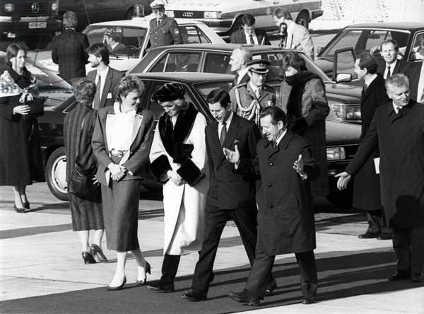 The Prince and Princess of Wales after their visit to Munich on the way to their plane at the airport Riem, 1987 (b/w photo)