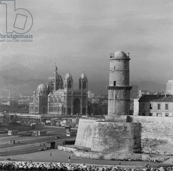 A tower and the Cathedral of Marseille, France, 1960 (b/w photo)