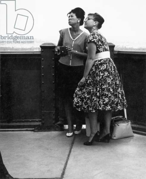 Two women on the Eiffel Tower, 1960 (b/w photo)