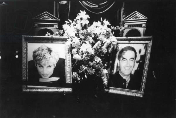 Flower-adorned portraits of the late Princess Diana and her friend Dodi al Fayed, 1997 (b/w photo)