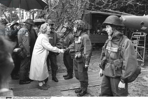 Margaret Thatcher with soldiers, 1986 (b/w photo)