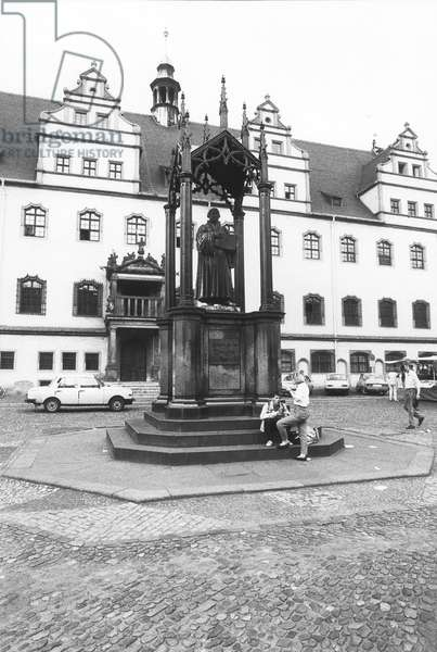 Monument of Martin Luther by Johann Gottfried Schadow in the square of Wittenberg, Germany, 1990 (b/w photo)
