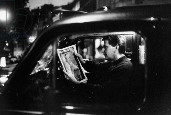 A taxi driver reads a report about Diana in his car, 6th September, 1997 (b/w photo)