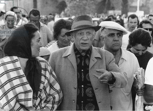 Pablo Picasso at a bullfight, accompanied by his barber Arias, Fréjus, August 7, 1966 (b/w photo)