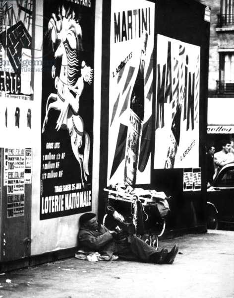 A homeless man in Paris, 1960 (b/w photo)