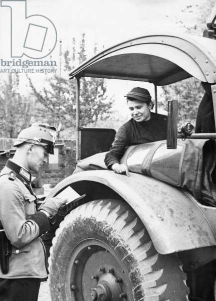 Reportage about a female tractor driver, 1939 (b/w photo)