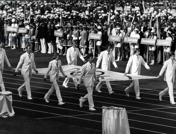 The Mexican rowing team carrying the Olympic banner at the opening ceremony for the Munich Olympic Games, 1972 (b/w photo)
