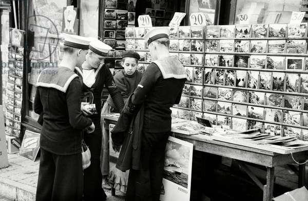 British sailors buying postcards (b/w photo)
