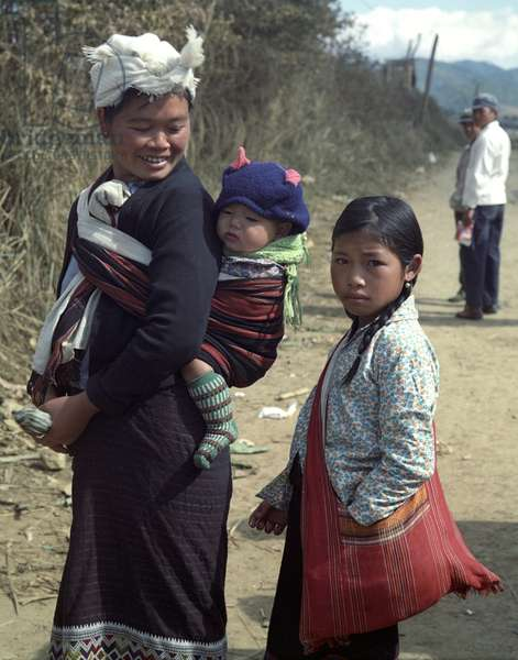 Women and children from the tribe of Meo (Hmong also) on a road near the so-called 'Plain of Jars' in Xieng Khouang province in Laos, 1977 (photo)