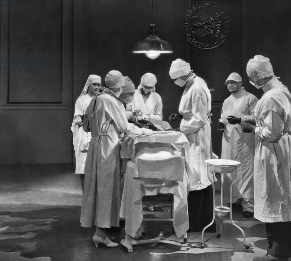Team of doctors in an operation (b/w photo)