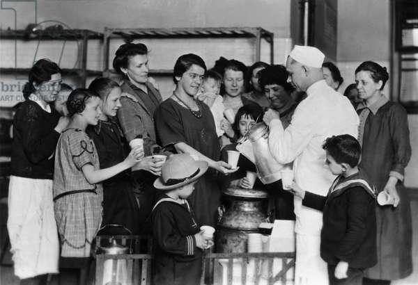 Beverage supply to immigrants on Ellis Island, 1928 (b/w photo)