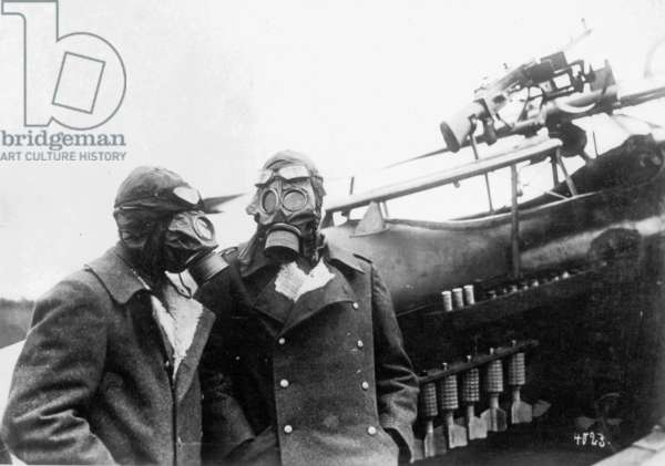 German pilots of the close support airplanes with gas mask prior to a deployment, 1916 (b/w photo)