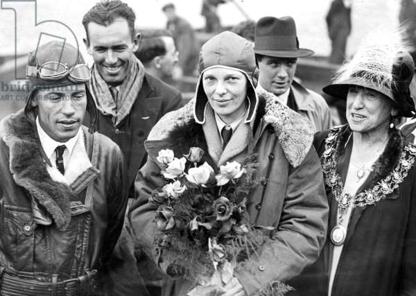 Amelia Earhart and the pilot Stultz after crossing the Atlantic (b/w photo)