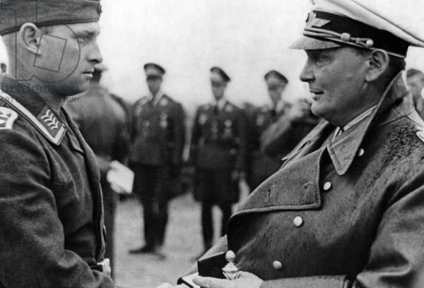 Hermann Göring honors a pilot with the Iron Cross 1st Class (b/w photo)